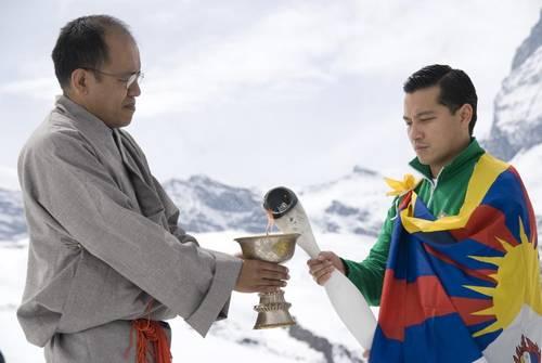 The Tibetan Freedom Torch is lit from a butterlamp in Zermatt, Switzerland. Photo: Tibetan Youth Association of Europe.